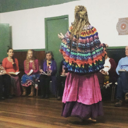 Casting the Circle, wearing thea's rainbow poncho.